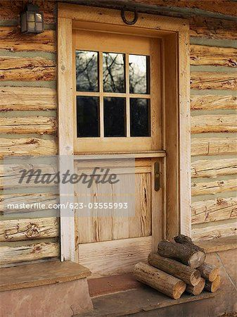 Firewood In Front Of Door Of Log Cabin Image
