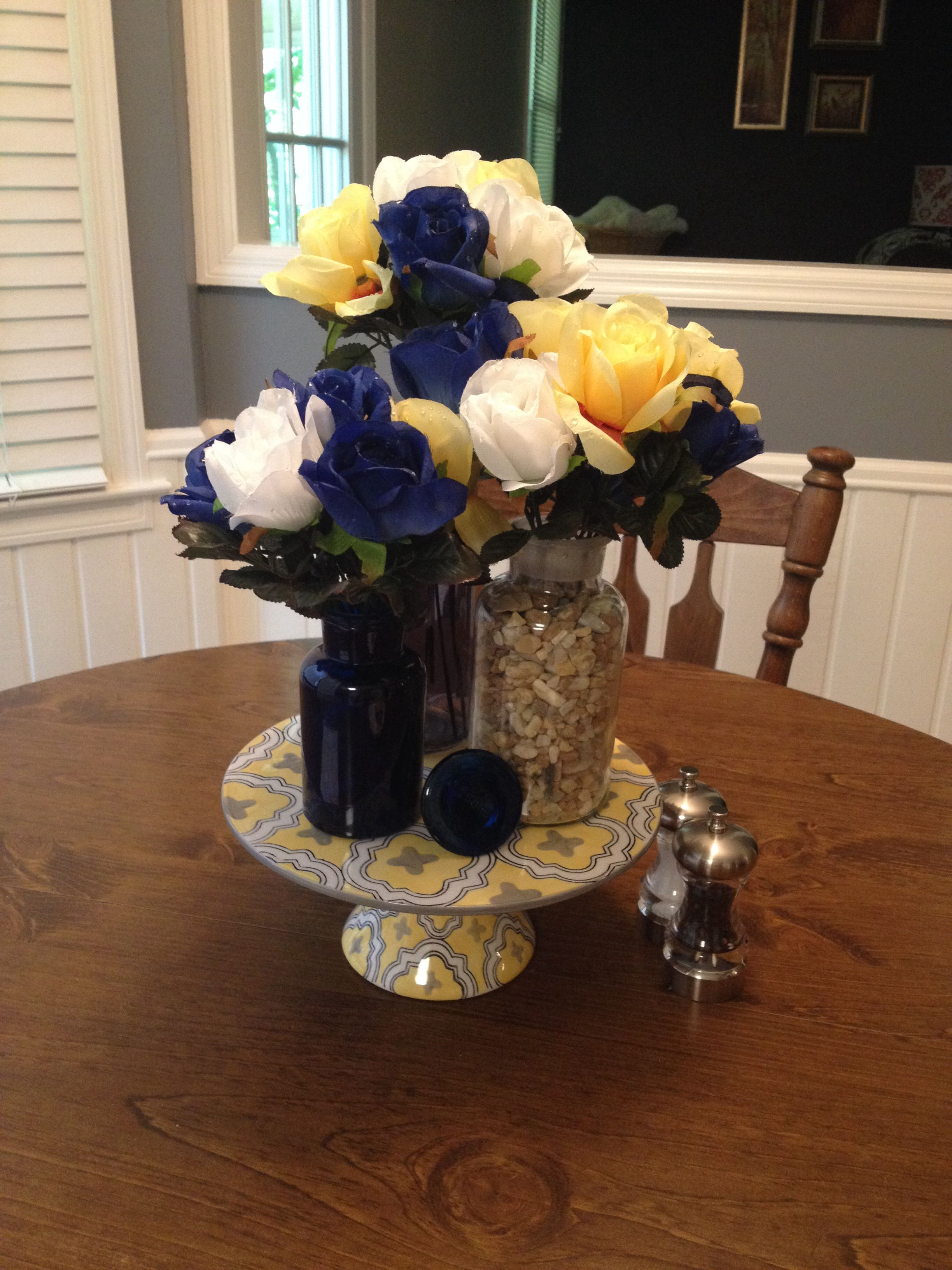 Blue, yellow, and white kitchen table centerpiece. Cake