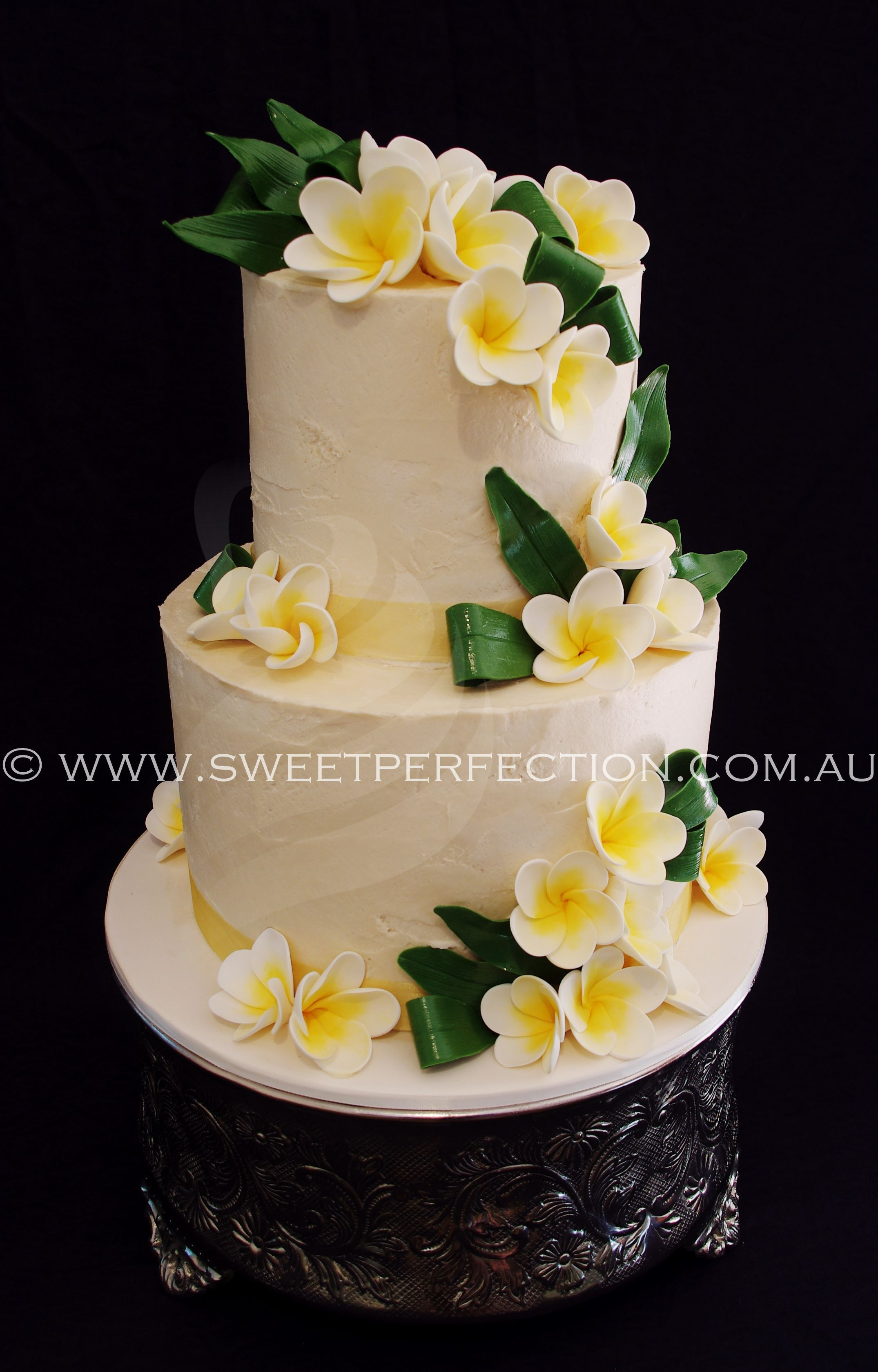 Sugar Frangipanis Plumerias And Greenery Accent This Lovely Buttercream Wedding Cake By Sweet Perfection