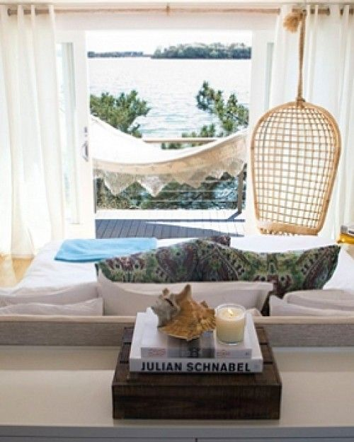 The Surf Lodge Montauk - Montauk, New York. Coffee-table art books decorate the rooms, outfitted with hanging rattan chairs and decks with hammocks. #Jetsetter #JSHammock
