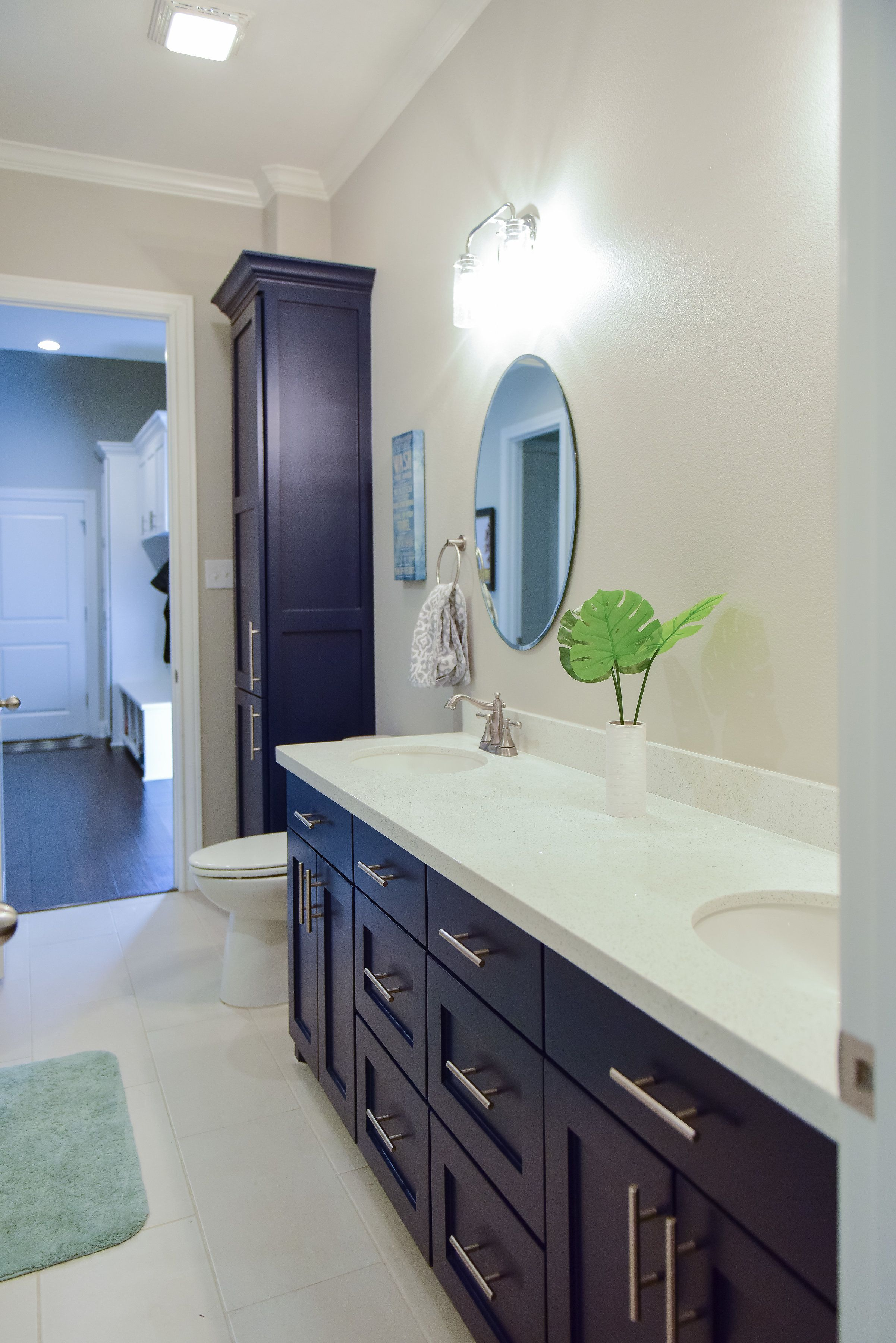Dark blue shaker style cabinets with quartz counters and under mount