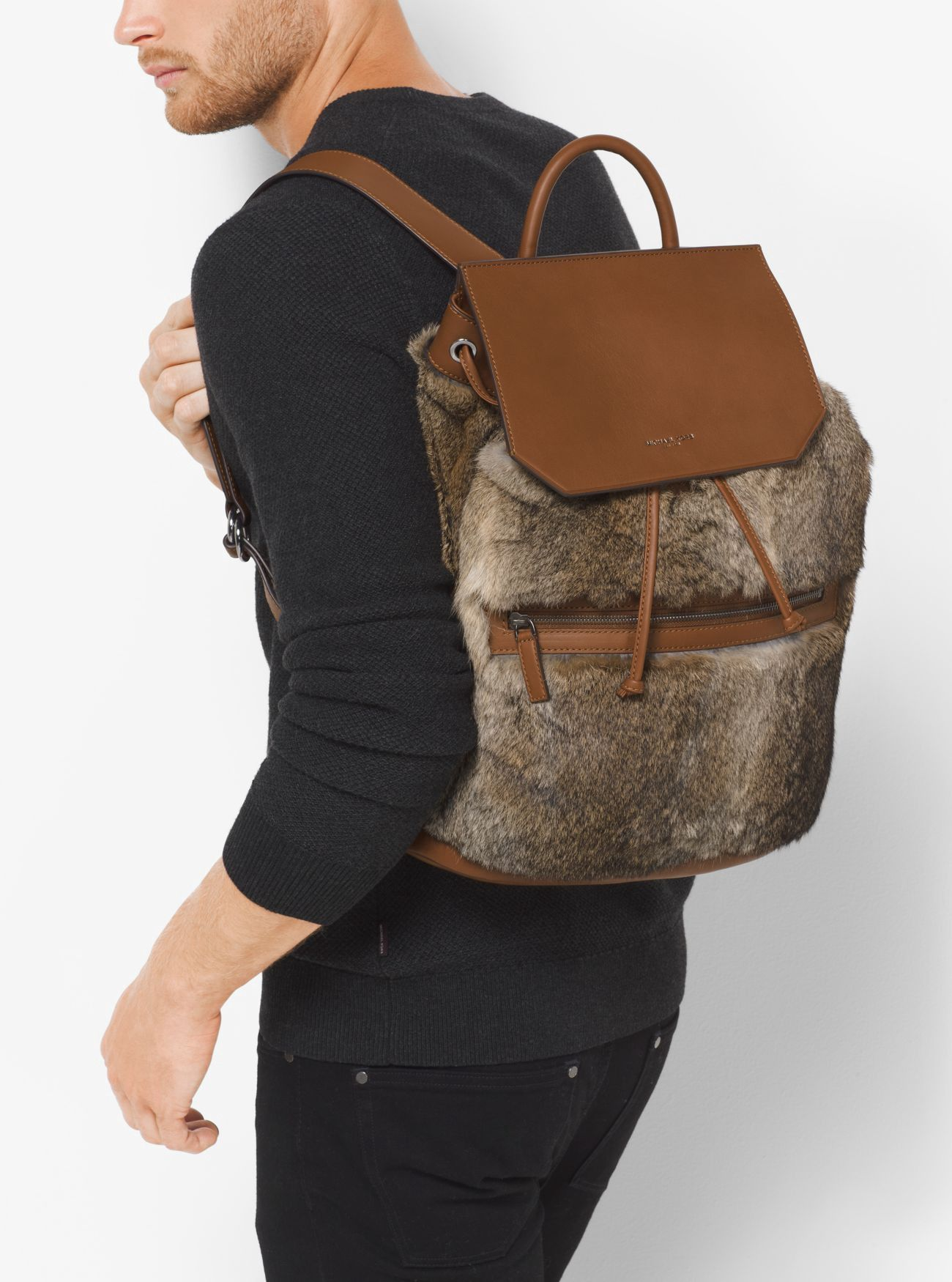 a2cebf05da99 ... sweden michael kors kirk fur and leather backpack. michaelkors bags fur  backpacks d99f5 c302c