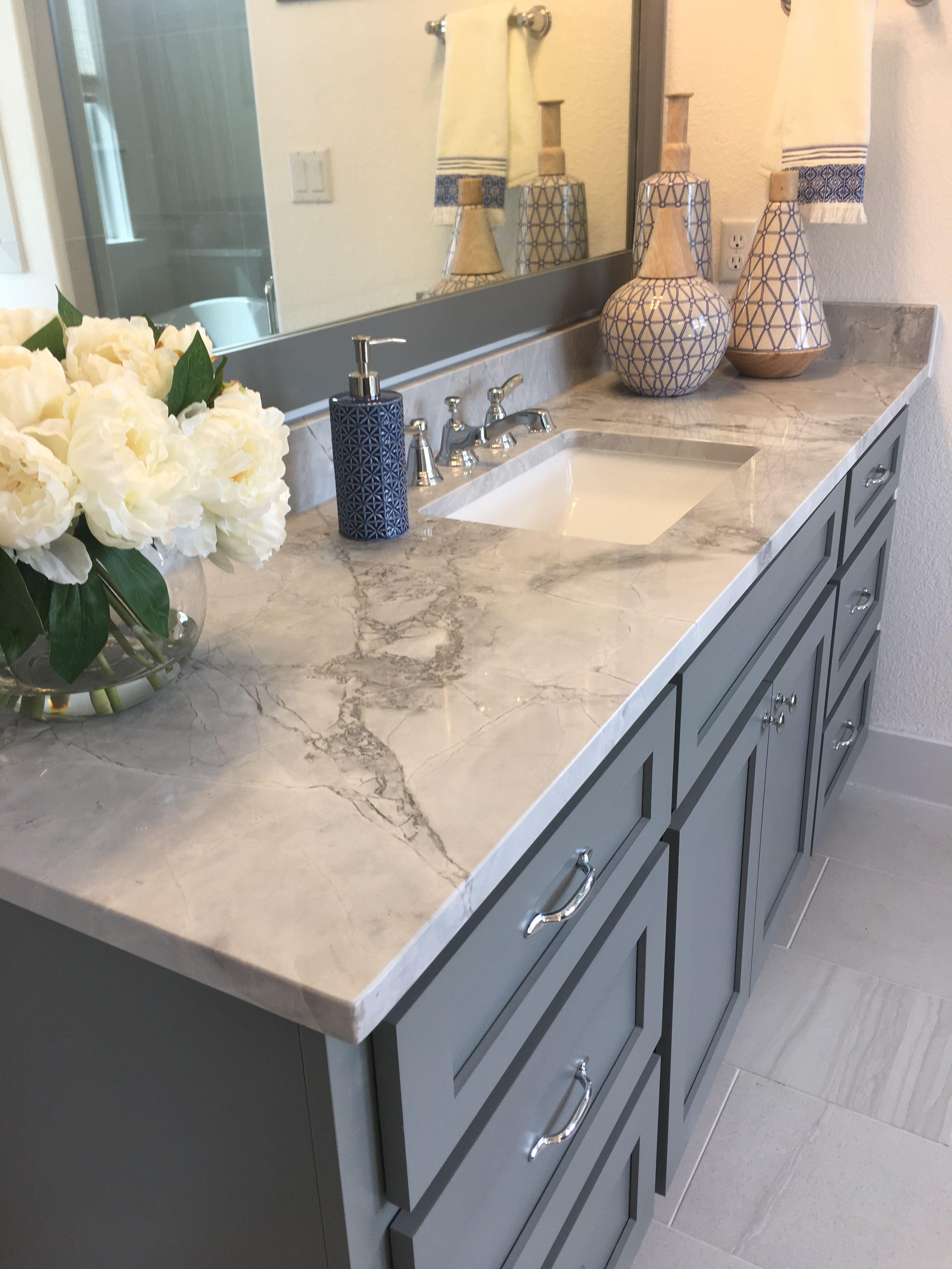 Master bathroom cabinet color with Grey Goose Quartzite countertops
