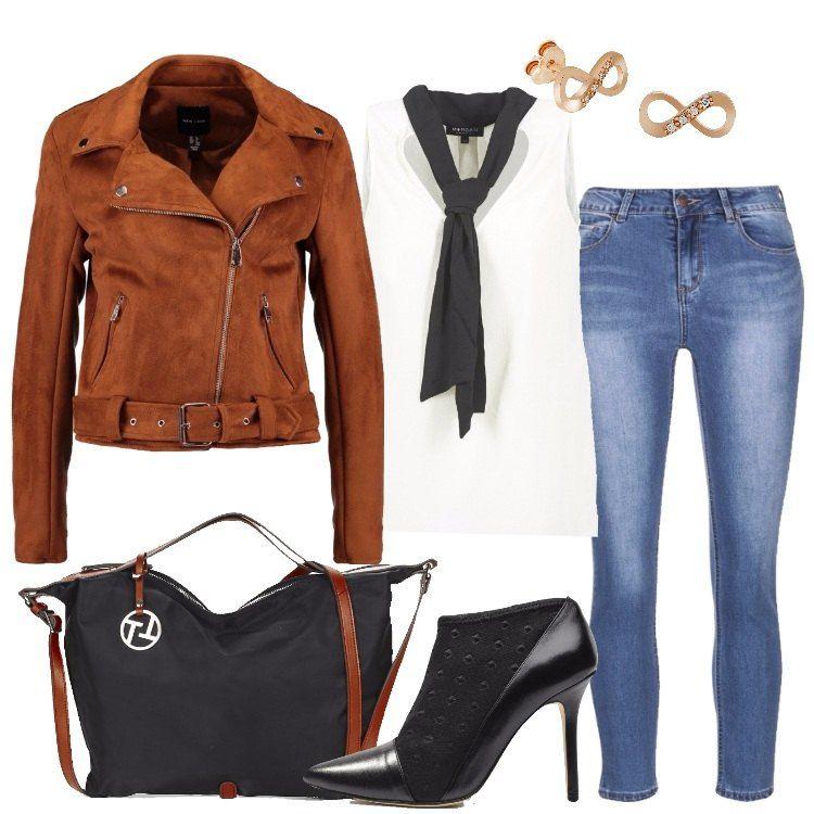 Outfit trendy in cui non può mancare il jeans slim fit