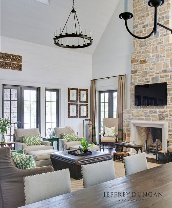Fresh farmhouse photo open concept living and dining room with brick fireplace
