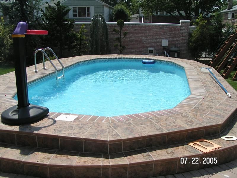 Semi Inground Pool Ideas semi inground pools are becoming very popular many people might have a high water table rock a hillside or any number of uncontrollable factors which Refreshing Semi Inground Pools With Natural Surroundings Gorgeous Semi Inground Pool Brick Wall Style Fence