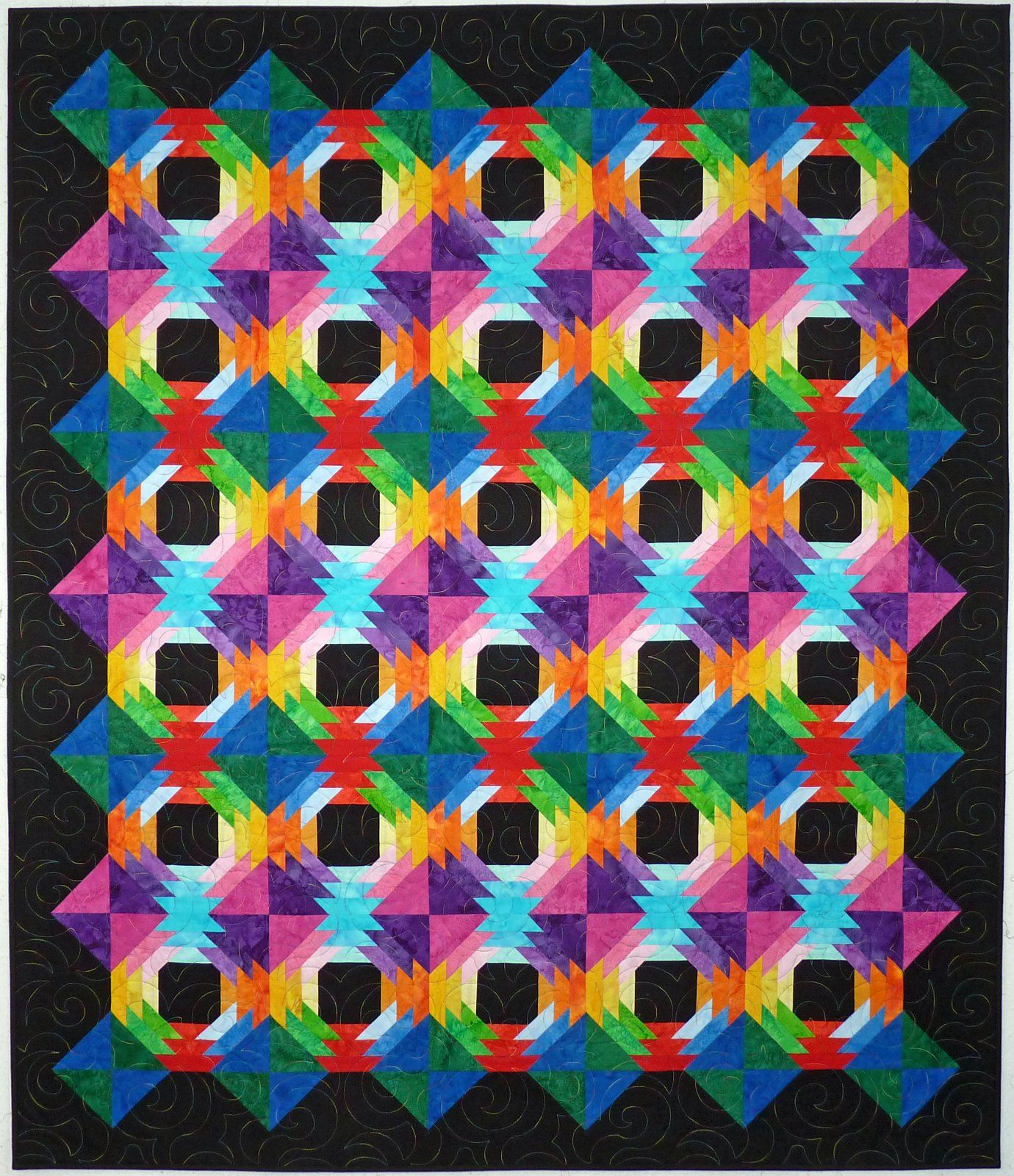 "Tropical Punch -Deliver a punch of color with this dynamic paper pieced project, with pieced borders to add interest.  The 51"" x 59"" quilt is an easy paper pieced pattern!"