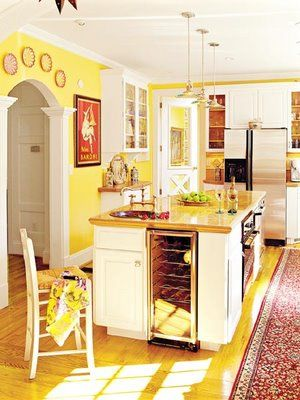 Yellow kitchen with pops of red. This is what I\'d probably end up ...