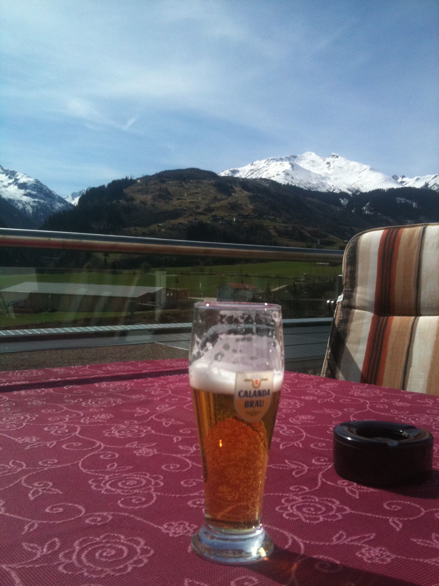 A Glass Of Beer And The Mountains Of Disentis Switzerland