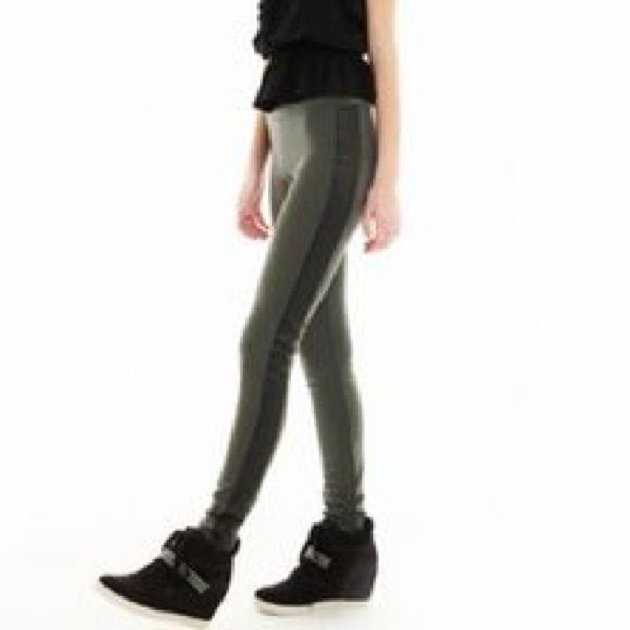 Scuba leggings with leather striping by Nanette Army green scuba leggings with black leather stripe down each leg. Elastic waist. Pant has spandex so has stretch. Great thick material. Brand is L'Amour by Nanette Lepore. Size XS. Nanette Lepore Pants Leggings
