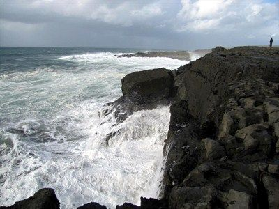 Popular view point of the cliffs and waves near the village of Ballyryan, County Clare, Ireland.