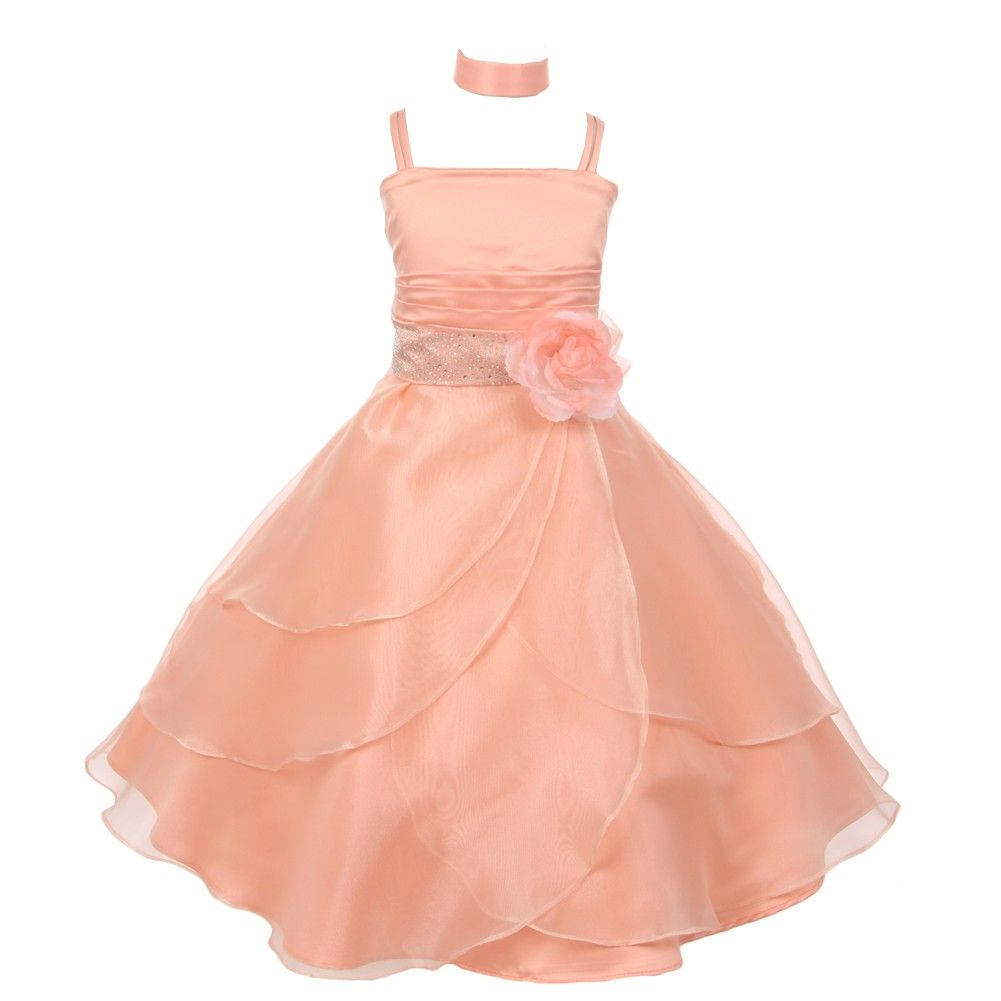 953049e6738 Fanciful dress with floral adornment from Shanil Inc just for your little  lady. The peach dress has spaghetti straps