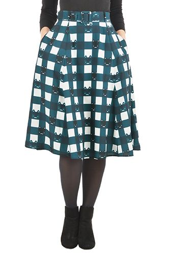 A self-belt beautifully cinches in the banded high waist of our feminine fifties inspired skirt patterned in a fun cat print with checks for whimsy.