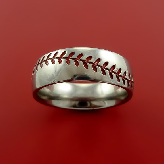 Titanium Baseball Ring with Red Stitching Fan Band Any Size and Color Red  Green, Blue, Black Inlay is part of Baseball ring - This 8mm wide TITANIUM ring has a POLISH FINISH and RED Stitching that encircles the band like a Baseball  The Stitching pattern is carved into the band with RED enamelfilled inlay Grooves  You have the option of inlay Color RED, BLACK, GREEN, or BLUE  Each ring is custom made and your ring comes