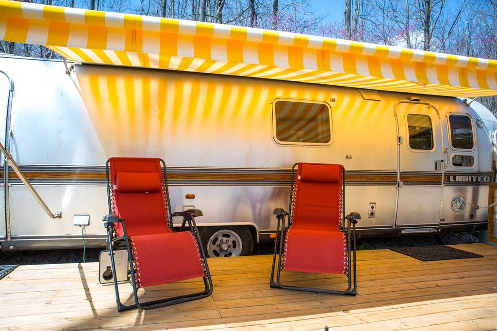 Meet The Dawn Treader Our Vintage Airstream Lounge Chairs Under Awning Await You