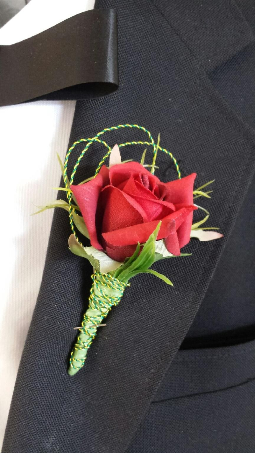 sample silk single red rose boutonniere with green wrapped stems and fancy wire loops