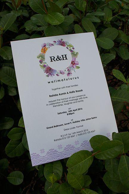 a purple flowers with batik graphics malay wedding