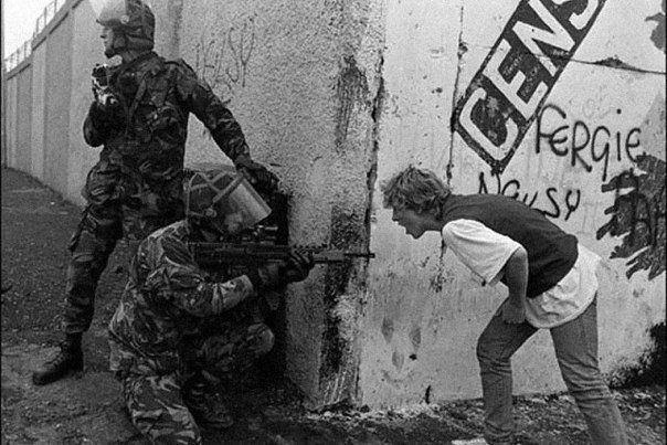 Irish teenager arguing with the British military, Belfast.