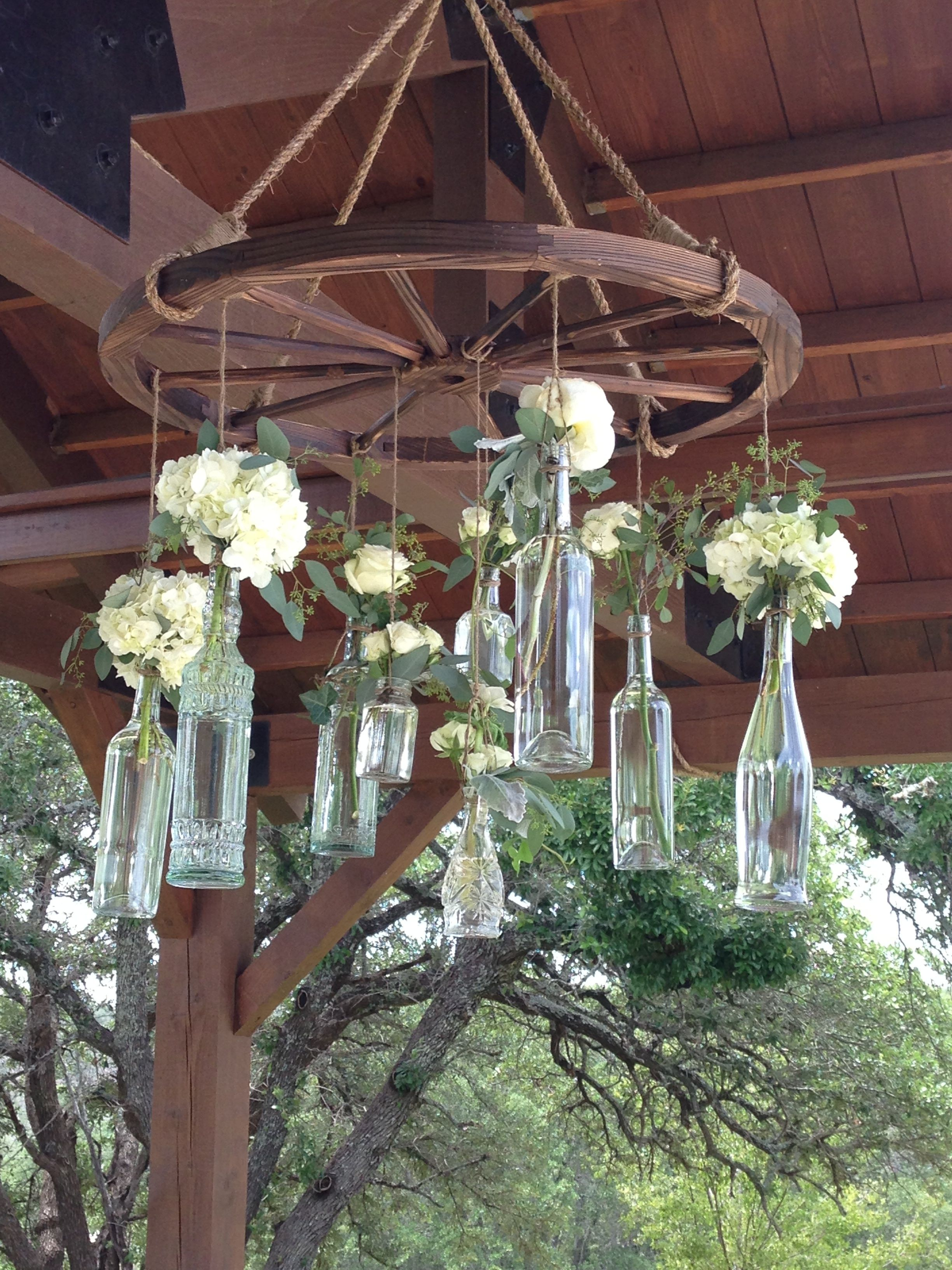 wagon wheel chandelier with vintage bottles