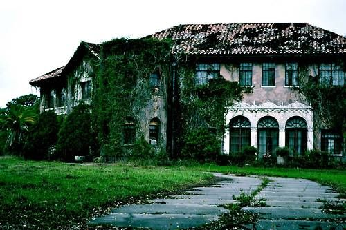The abandoned Howey mansion in Howey-In-The-Hills, Florida. This historic 20-room 8,800 square foot mansion built in 1925 by William J. Howey, a citrus grower,and founder of Howey-in-the-Hills Florida. It seems the owner Marvel Zona was taken advantage of by some real estate schemers and now the house is in foreclosure and she is in a nursing home.