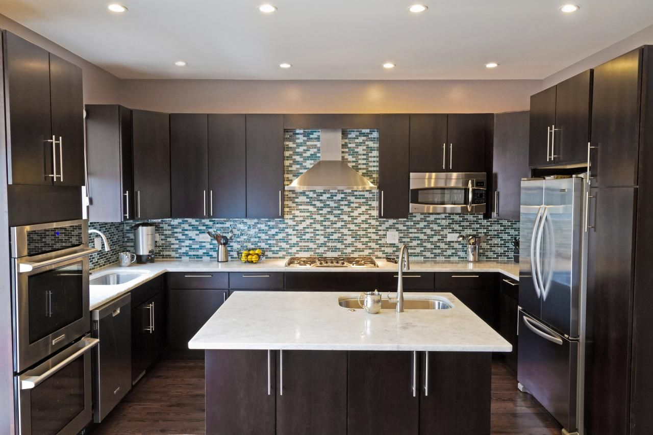 Blue back splash with dark cabinets. Cabinets too modern but a ...