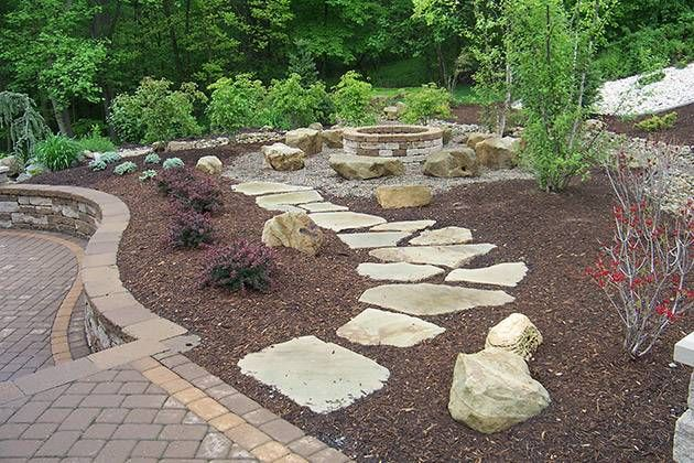 Cute stone path to pea gravel firepit area could do this for Gravel fire pit area