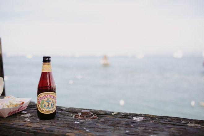 Anchor steam beer san francisco. California coast. Travel photography. San Francisco engagement photos. California wedding photographers. Fisherman's Wharf. Fun and unique wedding photography. Couples photography. Lifestyle photos.