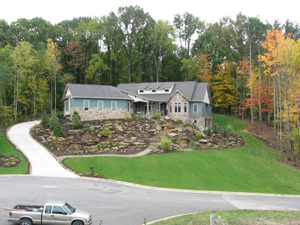 Landscaping with rocks lawn landscaping solution for Steep driveway construction