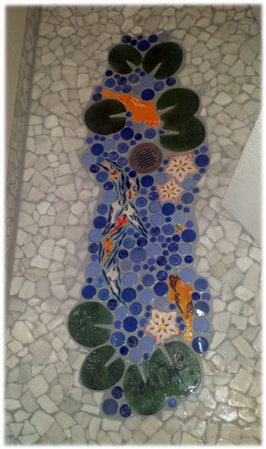 Another nice way to add some interest to a boring, sliced pebble floor is the addition of a small lily/koi/lotus pond.