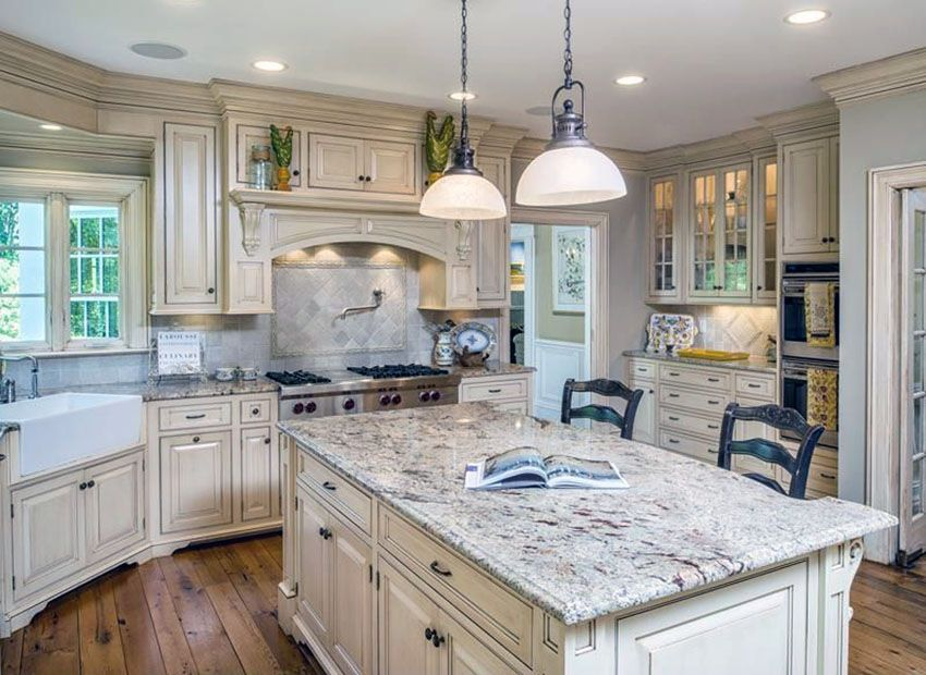 Country Kitchen With Off White Cabinets Bianco Antico Granite And Farmhouse Sink