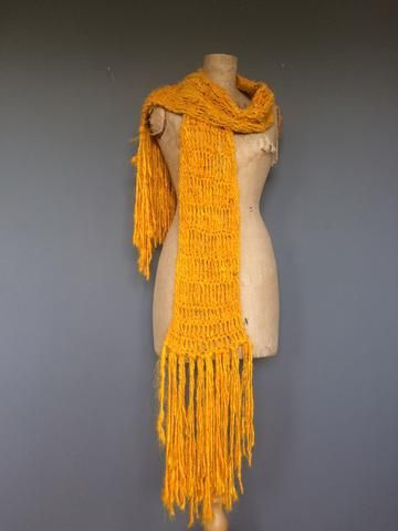 This pattern is for a very long sari silk yarn scarf with tassels. It is super warm, super soft and beautifully ethical. Ethical fashion with handspun yarns. Finished crochet scarf measurements. approx: 170cm long (Not including the tassels). Tassel length: Approx 30 cm but feel free to chop them! YARN USED: Handspun sari silk yarn in Kalka Yellow: 400g. ABBREVIATIONS: CH - chain St - stitch DC - Double Crochet TR - Treble Crochet SCARF Ch 21 Row 1: Dc in 4th chain from hook an...