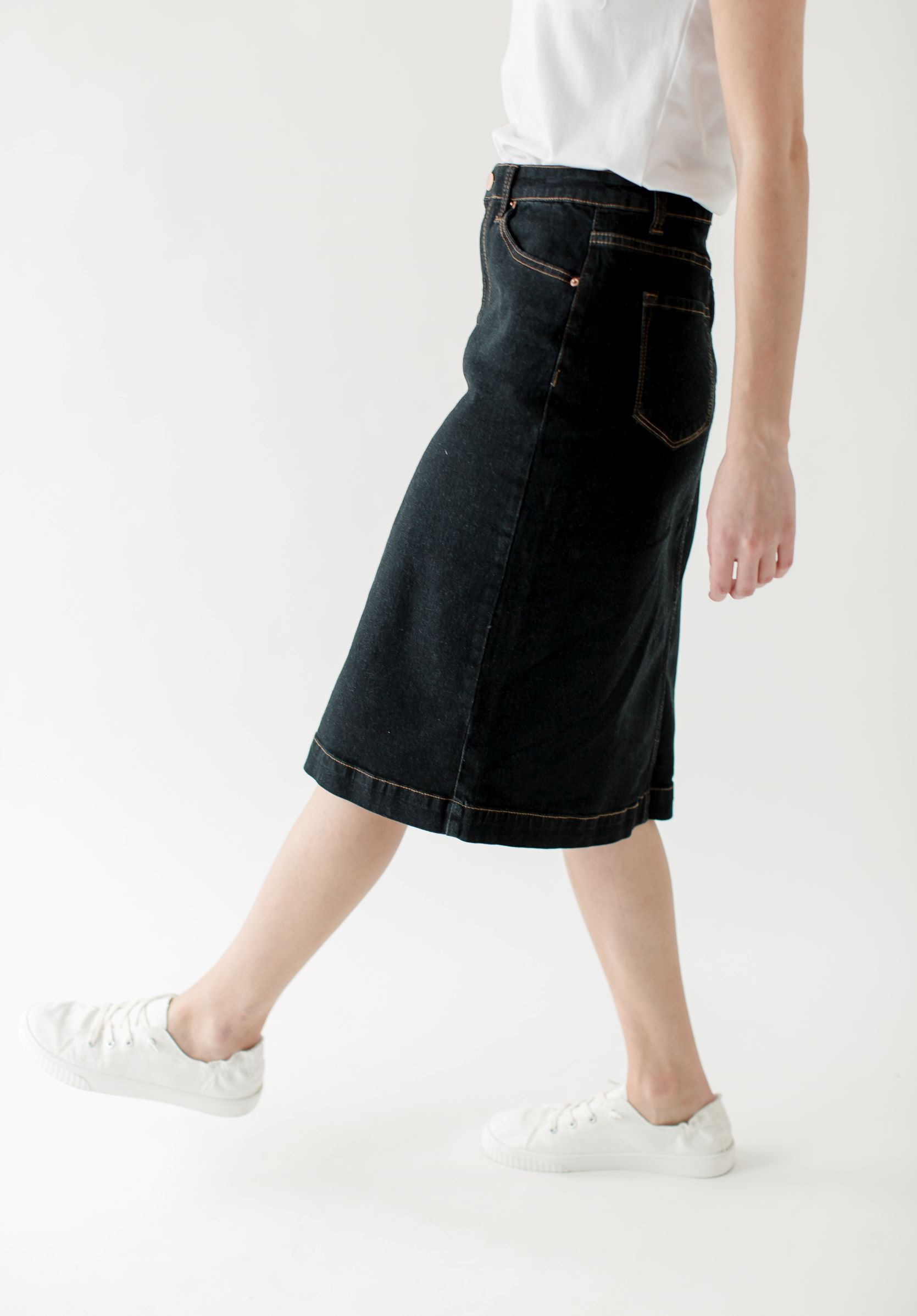 The 'Jia' is a dark wash denim skirt featuring a classic cut with simple lines! Feminine with a modern touch, this skirt pairs easily with a simple sweater and sneakers or ankle boots for life on the go. Exclusively designed by us for you! Also available in ankle length. 97% Cotton 3% Spandex Machine wash cold Do not bleach Hang to Dry Iron low heat Do not dry clean Have questions about fit?Call us! We try everything on, so we know how our clothes fit and we're happy to assist you. Customer Serv