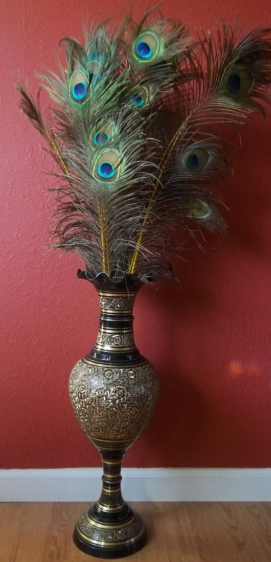 Peacock feathers in vase living space pinterest