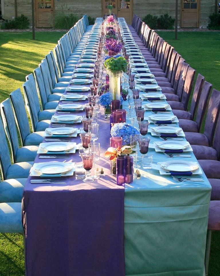 event table with beautiful colored linens and chairs. rentals