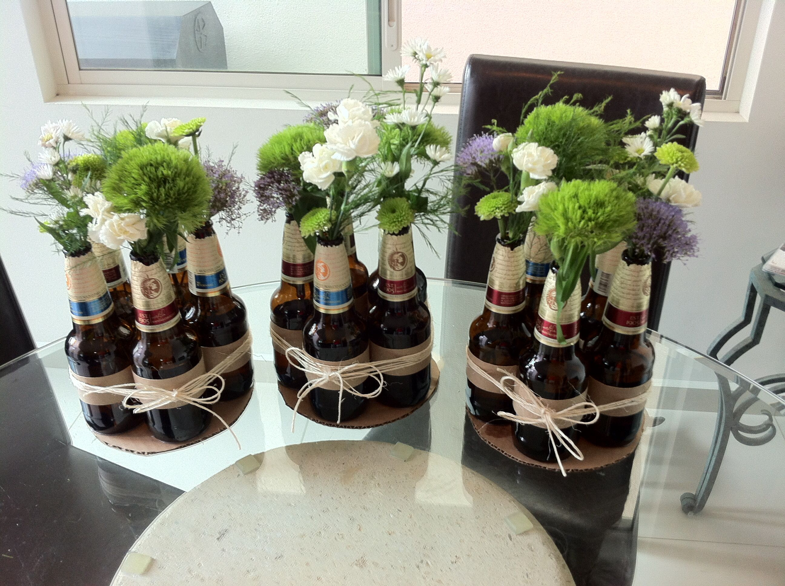 Beer bottle centerpiece party for him retirement party for Rustikale dekoration