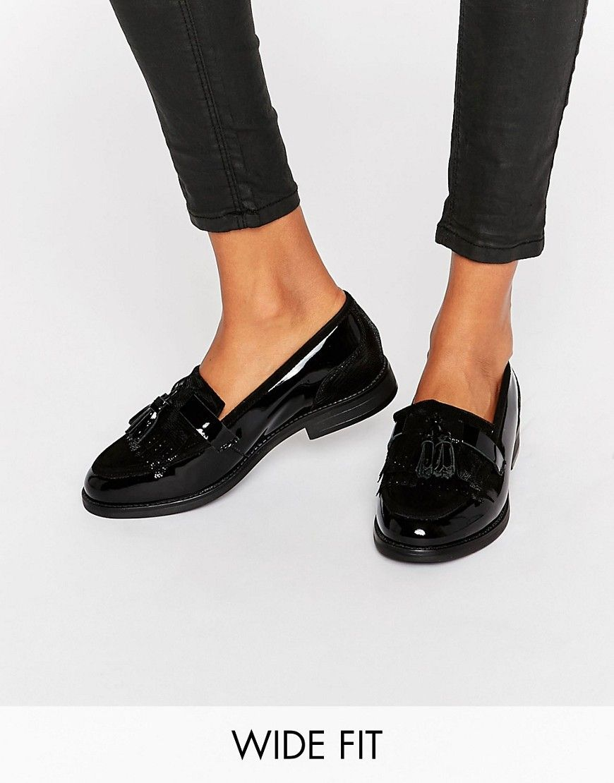 3a7f30fcb10 Image 1 of Dune Wide Fit Goodie Black Patent Tassle Loafers