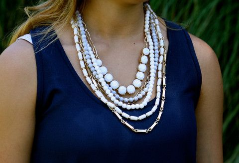 love this statement necklace in the black and gold!