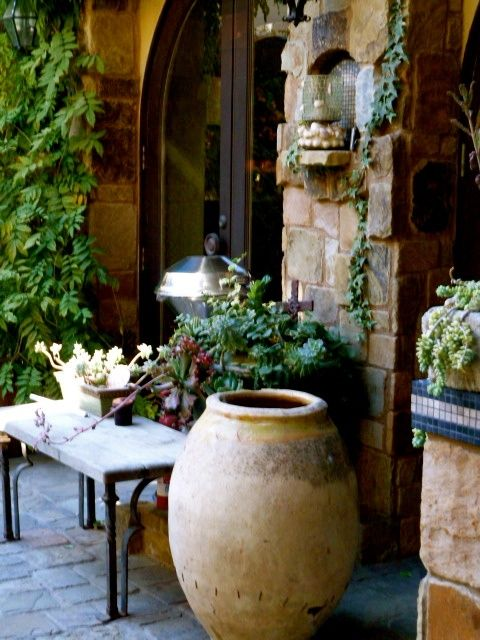 Our courtyard tuscan courtyard landscape outdoor for Tuscan courtyard landscaping