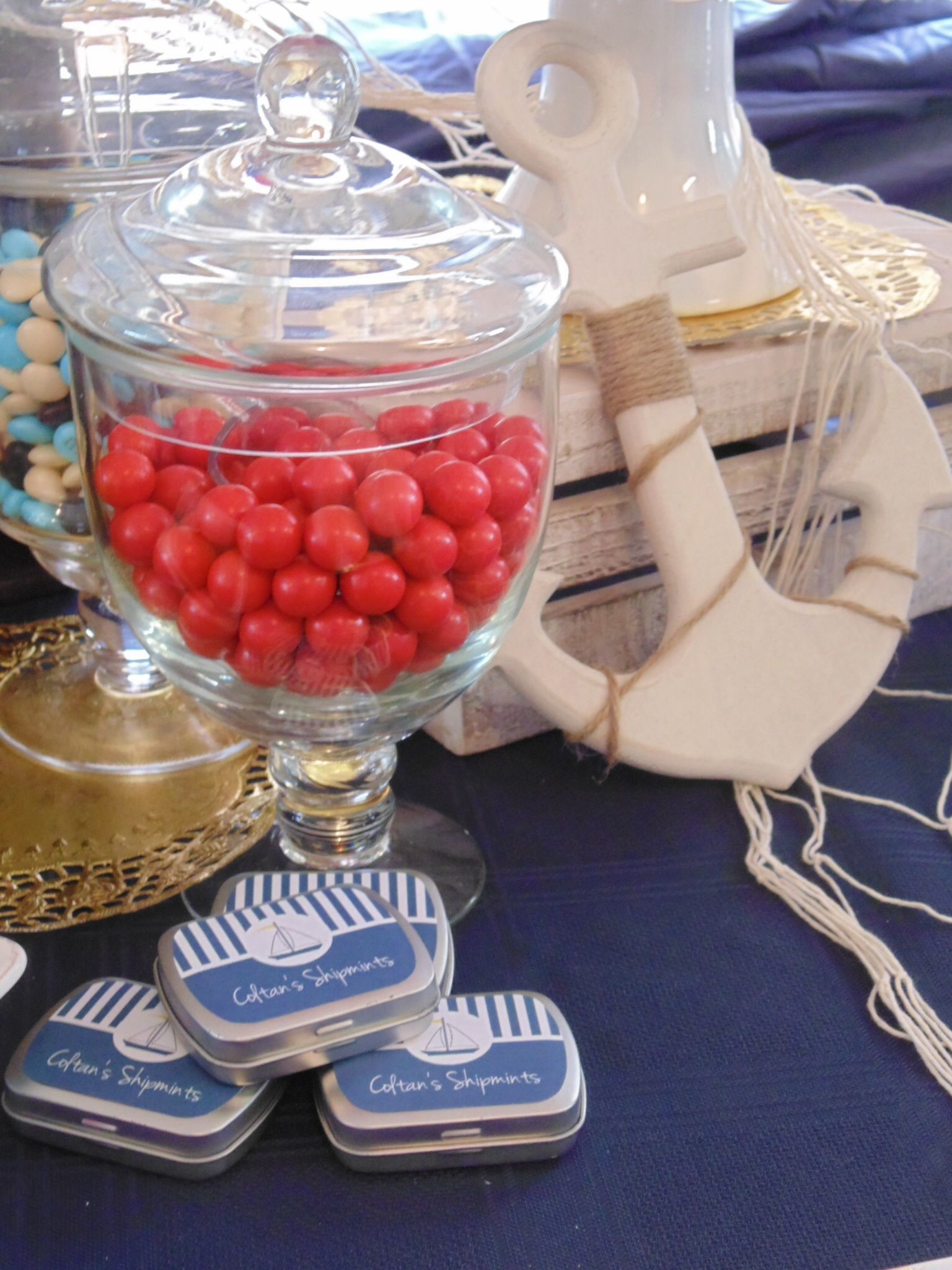 Mint tin favours for nautical party and Jaffa for a pop of red