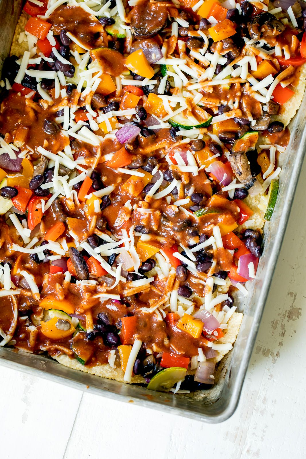 Chipotle Black Bean Roasted Veggie Enchilada Casserole Layers of veggies snuggled between black beans, tortillas, a homemade chipotle enchilada sauce and cheese - best & easiest vegetarian enchilada casserole!