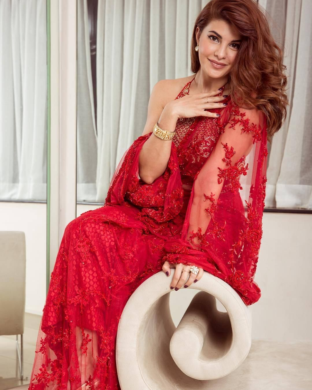 26710b510c Jacqueline Fernandez fabulous in a bright red netted embroidery saree from  Faraz Manan