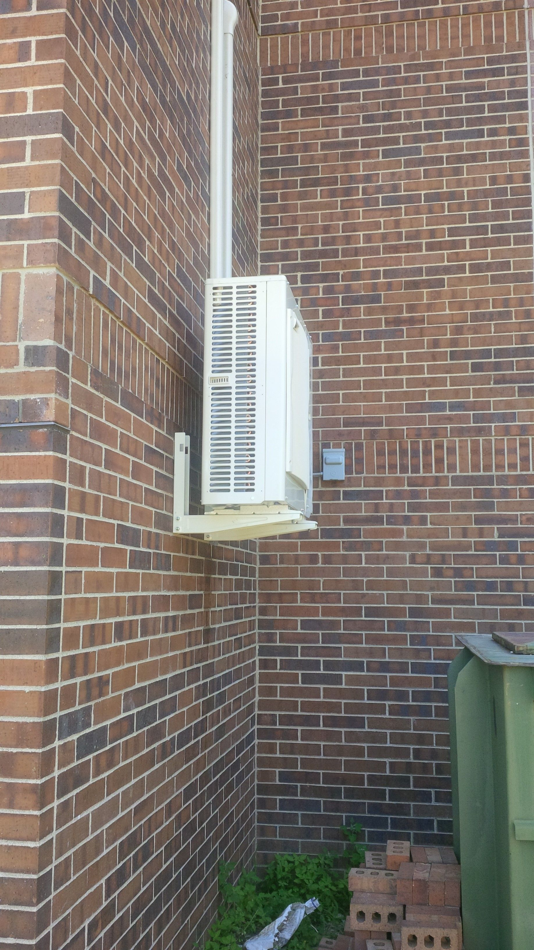 Mitsubishi Condenser Mounted On Bracket In Brick Building Ductless Heating Heating And Cooling Industrial Hvac