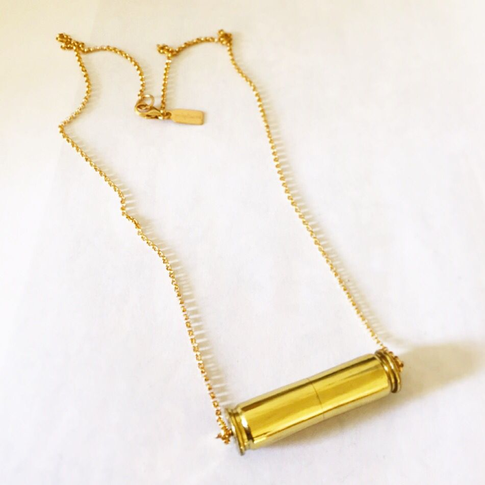 Bullet Necklace, recycled from used brass bullet casings, soldered evenly, hand sanded and hand polished byNEEKO. $45