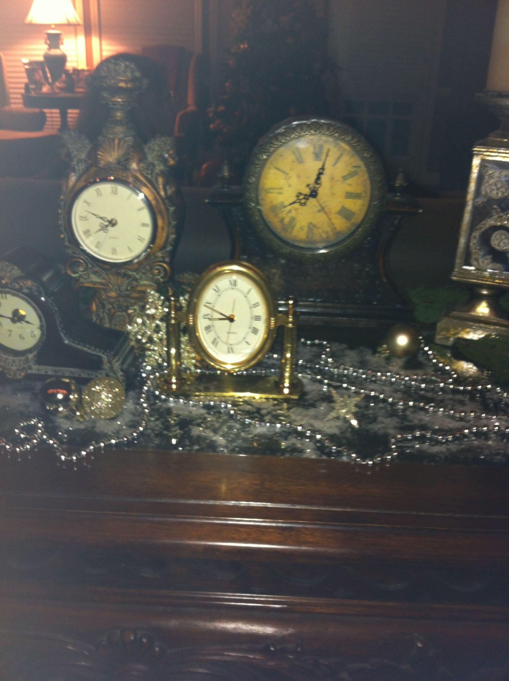 Inexpensive New Years decor! Clocks gathered from around ...