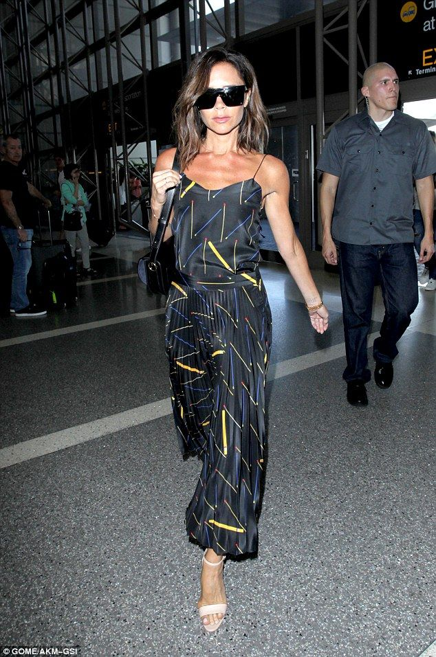 e0b2509f3 Passing through: She positively floated through departures in her pleated  number Victoria Beckham Outfits,