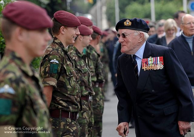 A Royal Navy D Day Veteran Jokes With Young Paratrooper At The 65th Commemoration Of Event On June 6th 1944