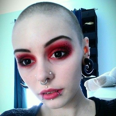 Female shaved and pierced