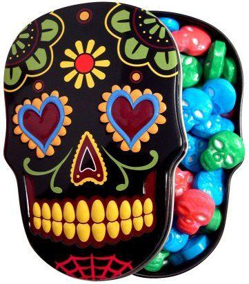 Sugar Skull Candy Tin. Each tin holds 1.4 oz of brightly-colored skull shaped candies. / Pastilleros en forma de calavera de azúcar, cada uno contiene 40 gramos de calaveritas de caramelo en colores brillantes.