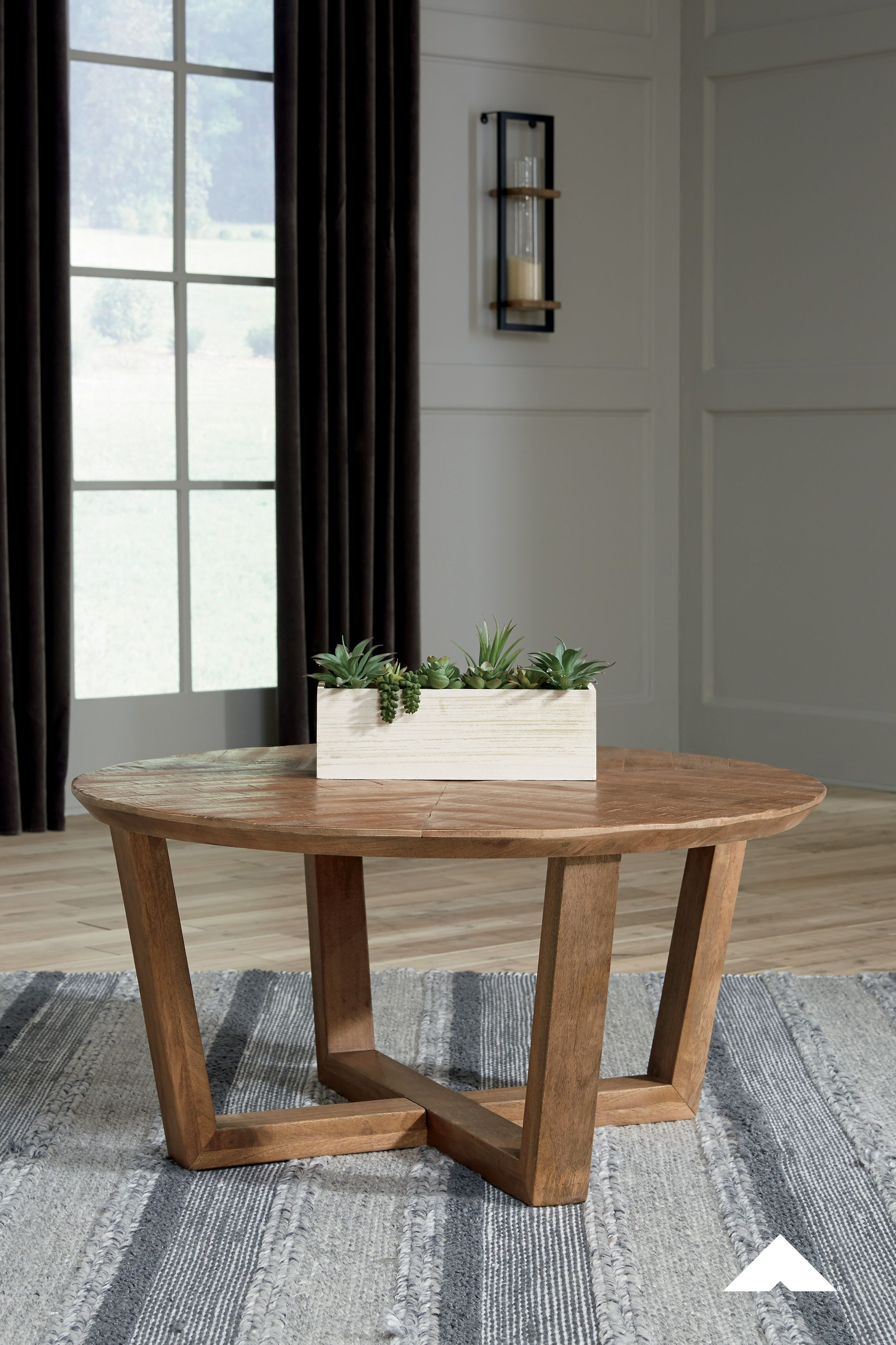 Kinnshee Brown Round Cocktail Table Round Out Your Seating Area