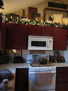 cosy ideas for decorating on top of kitchen cabinets. I like the idea of Christmas lights on top my  KitchenCozy Oooooh